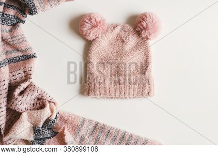 Handmade Knitted Hat With Two Pompoms And Warm Scarf Of Pink Color On White Background, Top View. Au
