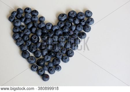 Heart Shape Of Heap Of Fresh Blueberry On The White Background Close Up Taken With Copy Space At Rig