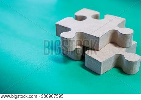 Jigsaw Puzzle Pieces For Teamwork On Blue Paper Background, Teamwork Put Pieces Together To Connect