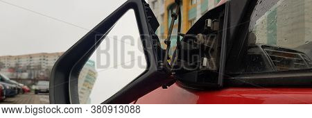 Close-up Of Broken Side Window. Auto With Damage. Cracked Glass. Damaged Transport Vehicle. Red Colo