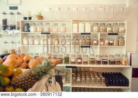 Eco-friendly Zero Waste Shop Interior. Dispensers For Cereals, Nuts And Grains In Sustainable Plasti