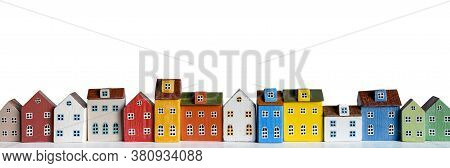 Colorful Miniature Houses Arranged In A Row On White Background. Urban City Background Banner. Copy