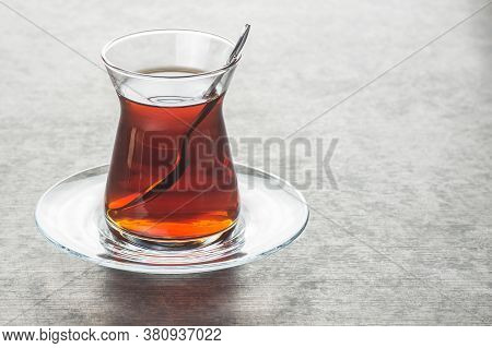 Glass Turkish Brewed Black Tea On Black Rustic Background. Turkish Traditional Hot Drink