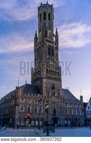 Brugges, Belgium - November 2019: Old Tower In Central Square In Brugges, Belgium.