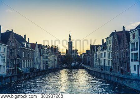 Brugges, Belgium - 14 November 2019: Old Buildings Along Canal In Brugges, Belgium.