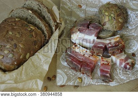 On Paper Slices Of Bread With Slices Of Bacon And Onions Close Up