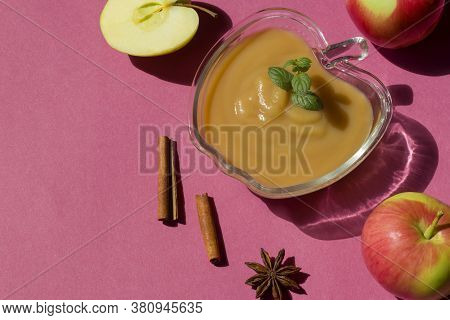 Healthy Organic Homemade Applesauce, Mousse, Sauce In Glass Bowl Over Pink Background. Organic Natur