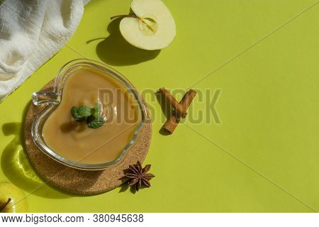 Healthy Organic Homemade Applesauce, Mousse, Sauce In Glass Bowl On Green Background. Organic Natura