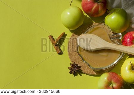 Healthy Organic Homemade Applesauce. Mousse, Sauce In A Glass Bowl On A Green Background With A Wood