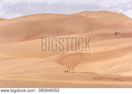 Photograph Of The Large, Impressive Sand Dunes At Great Sand Dunes National Park And Preserve With G