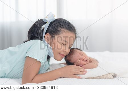 Sister Happy Welcome Her Little Brother. Toddler Kid Meeting New Sibling. Cute Girl And New Born Bab