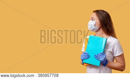 School Reopen. Quarantine Education. Cautious Female Student In Protective Face Mask Gloves With Boo