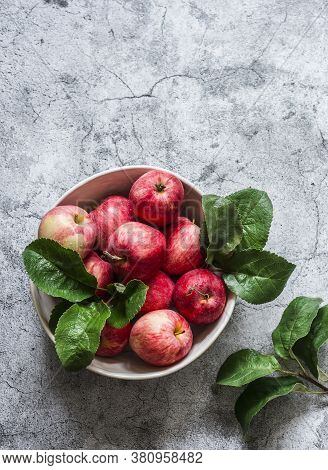 Fresh Ripe Apples In A Bowl On A Grey Background, Top View. Copy Space