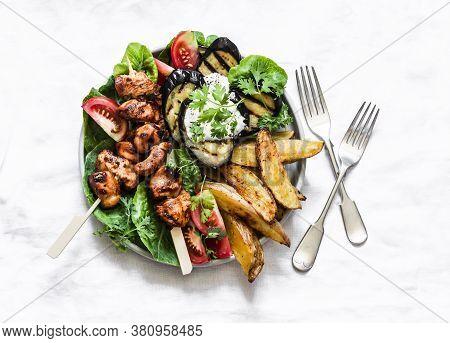 Teriyaki Chicken Skewers, Baked Potatoes, Vegetables, Grilled Eggplant - Delicious Appetizer Plate,