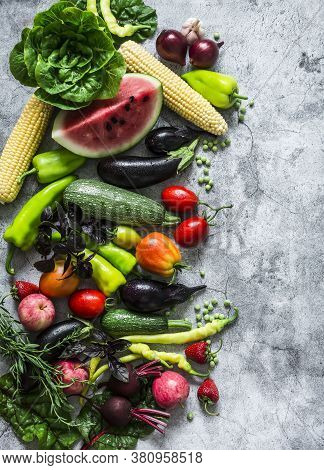 Garden Organic Vegetables, Berries, Fruits On A Gray Background, Top View. Healthy Diet Vegetarian F