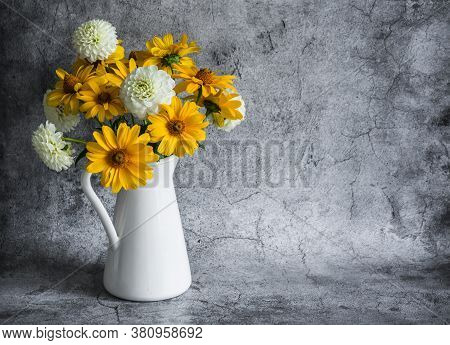 Autumn Flowers Yellow And White Dahlias Bouquet In A Vintage White Jug On A Gray Background, Front V