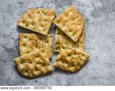 Homemade Crunchy Italian Focaccia On A Grey Background, Top View. Traditional Italian Bread