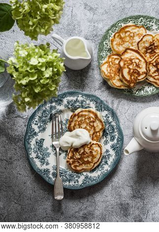 Morning Breakfast Still Life - Apples Pancakes With Sour Cream, Teapot, Bouquet Of Hydrangeas On A G