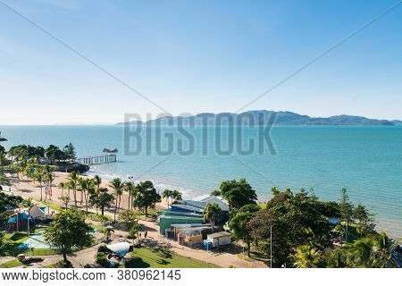 Townsville, Australia - June 19, 2019: View Of Magnetic Island And The Jetty On The Strand Beach