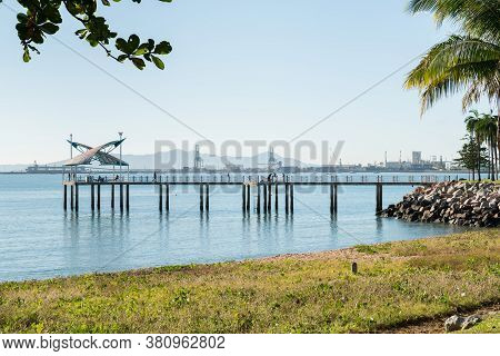 Fishermen In The Morning On A Warm Winter's Day On The Strand Jetty, Townsville With The Port Behind