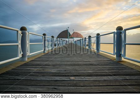 Early Morning With Sunrise On The Strand Jetty Or Pier In Townsville, North Queensland