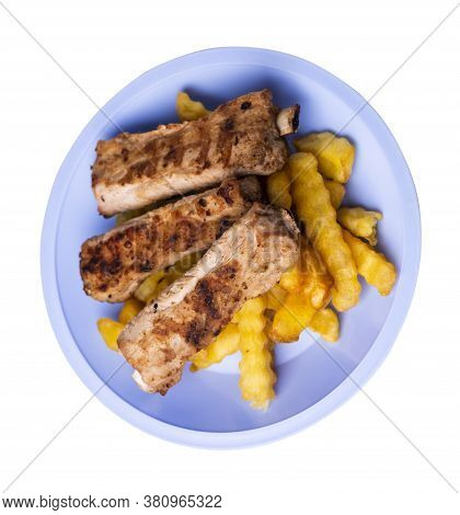 Grilled Pork Ribs With French Fries On Light Blue Plate. Pork Ribs With French Fries On A White Back