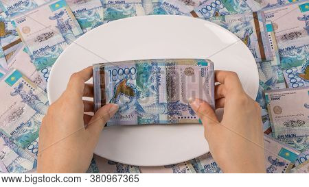 A Lot Of Kazakhstan Tenge In A Circle On The Table. The National Currency Of Kazakhstan. Salary In T