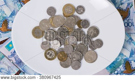 A Lot Of Money Kazakhstan Tenge In A Circle On The Table. The National Currency Of Kazakhstan. Salar