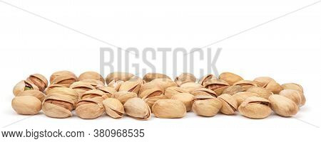 Pistachio Heap Isolated On White Background. Pistachios Panorama. Nuts Pile