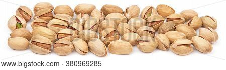Pistachio Heap Isolated On White Background. Pistachios Close-up Panorama. Nuts Pile
