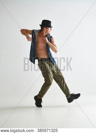 Cool Young Man Breakdancer In Hat Dancing Hip-hop In Studio Isolated On White Background