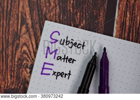 Sme - Subject Matter Expert Write On A Book Isolated On Office Desk.