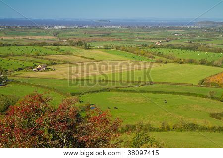Brent Knoll hill on the Somerset Levels in Somerset, England. poster
