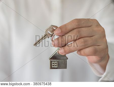 House Key In Real Estate Sale Person, Landlord Or Home Insurance Broker Agent's Hand Giving To Buyer