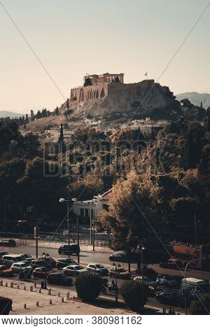 ATHENS - SEP 26: Street view with Acropolis on September 26, 2016 in Athens, Greece. Athens is one of the world's oldest cities with the history of 3400 years.