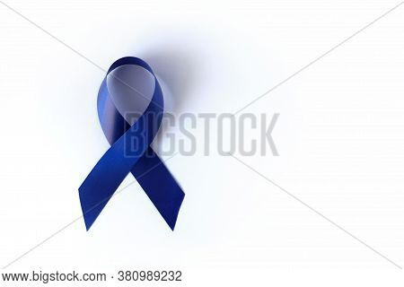 Blue Ribbon On A White Background Is A Symbol Of The Problem Of Stevens-jones Syndrome, Colon Cancer