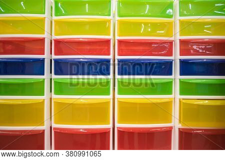 A Colorful Plastic Container Abstract Background. Front View.