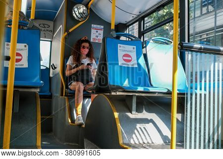 Belgrade / Serbia - August 8, 2020: Young Girl Wearing A Medical Face Mask On Belgrade City Public B