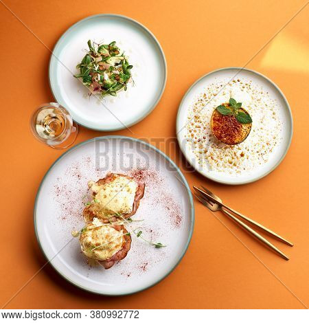 Benedict Eggs - Poached Eggs And A Delicious Avocado Salad, Dessert Cr Me Brulee In Orange Backgroun