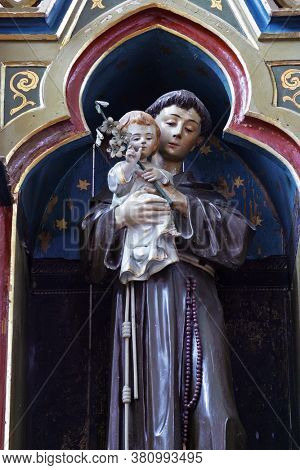 LUKA, CROATIA - SEPTEMBER 16, 2012: St. Anthony holds the baby Jesus statue on the altar of St. Anthony of Padua at St. Roch Church in Luka, Croatia