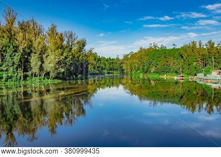 Lake Pristine With Green Forest Water Reflection And Bright Blue Sky At Morning Image Is Taken At Oo