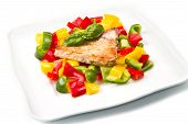 a fried tuna fillet with colored pepper poster