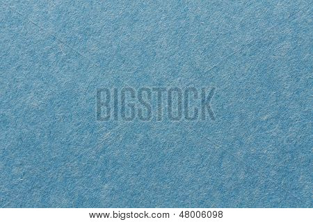 close up aka macro shot of blue construction paper, showing texture, paper fibers, flaws, and more. the perfect image for all your colored construction or recycled paper needs