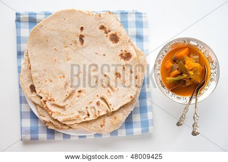 Chapatti roti or Flat bread and curry dahl. Indian food on dining table.