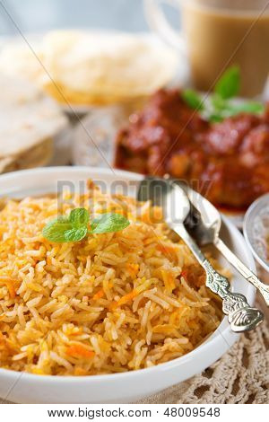 Indian cuisine biryani rice and chicken curry. poster