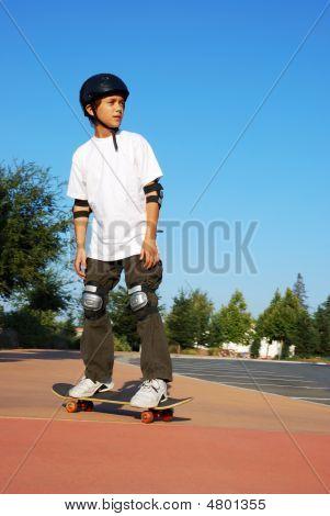 Teen Boy On Skateboard