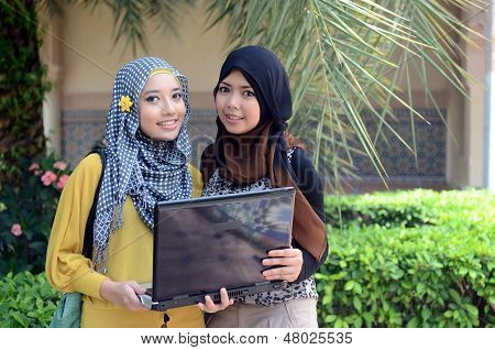beautiful young muslim businesswoman sharing info