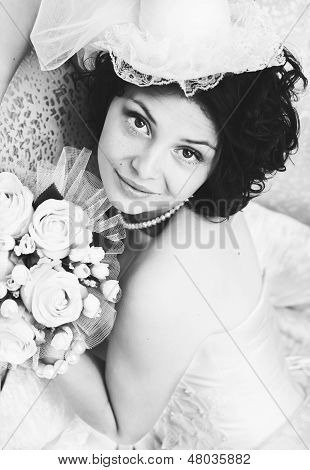 Black and white portrait of young brunette bride
