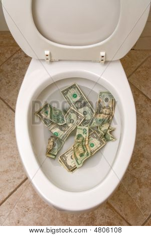 A pile of money getting ready to be flushed down the toilet. poster