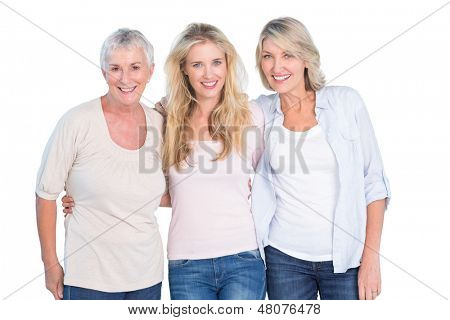 Three generations of women smiling at camera on white background